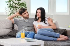 Couple sitting on a couch Stock Photography