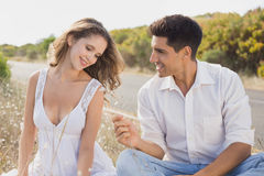 Couple sitting on countryside landscape Royalty Free Stock Image