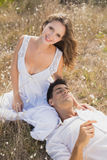Couple sitting on countryside landscape Stock Images