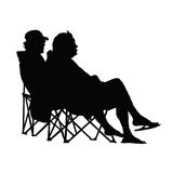 Couple sitting and enjoying vector silhouette Royalty Free Stock Image