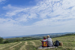 Couple sitting in the field Stock Image
