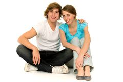 Couple sitting on floor Royalty Free Stock Photos