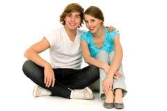 Couple sitting on floor Royalty Free Stock Photos