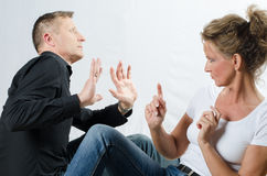 Couple sitting on the floor and arguing Royalty Free Stock Photography