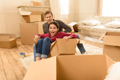 Couple sitting on floor with boxes at new home Royalty Free Stock Photo