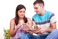Couple sitting on the floor and eating Royalty Free Stock Images