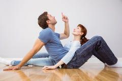 Couple sitting on the floor Stock Photo