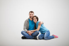 Couple sitting on the floor Royalty Free Stock Images
