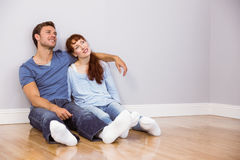 Couple sitting on floor together Royalty Free Stock Image
