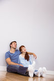 Couple sitting on floor together Royalty Free Stock Photography