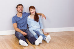 Couple sitting on floor together Royalty Free Stock Photos