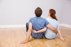 Couple sitting on floor together Stock Photos