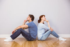 Couple sitting on floor together Stock Image