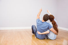 Couple sitting on floor together Royalty Free Stock Photo
