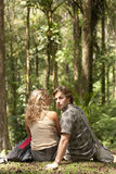 Couple Sitting in Forest Stock Photography