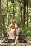 Couple Sitting in Forest Stock Photo