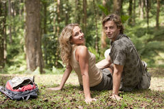 Couple Sitting in Forest Stock Image