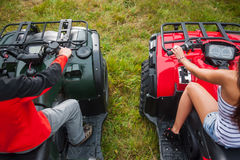 Couple sitting on four-wheeler ATV. View from the back Stock Photo
