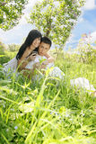 Couple sitting on the grass Royalty Free Stock Image