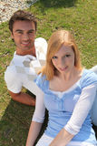 Couple sitting on grass Royalty Free Stock Photography