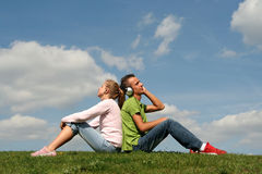 Couple sitting on grass Royalty Free Stock Photo