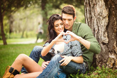 Couple Sitting On The Grass In The Park Royalty Free Stock Photos