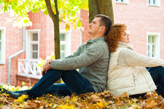 Couple sitting on ground Royalty Free Stock Photos