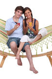 Couple sitting in a hammock Stock Image