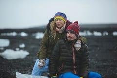 Couple Sitting on Ice Block stock photography