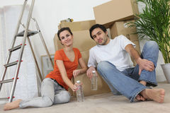 Couple sitting inside an apartment Royalty Free Stock Images