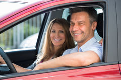 Couple Sitting Inside The Car Royalty Free Stock Images