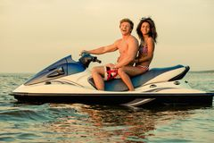 Couple sitting on a jet ski Royalty Free Stock Photography