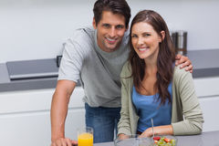 Couple sitting in the kitchen Royalty Free Stock Images