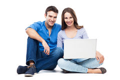 Couple sitting with laptop Royalty Free Stock Photos