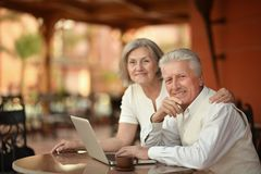 Couple sitting with laptop Stock Photography