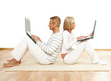Couple sitting with laptops Royalty Free Stock Photo