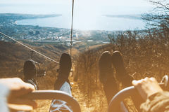 Couple sitting in lift chair of cableway. Low contrast effect Royalty Free Stock Images