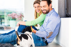 Couple sitting in living room floor royalty free stock photos