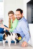 Couple sitting in living room floor stock photography