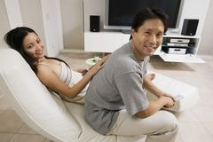 Couple sitting in Living Room Together Royalty Free Stock Photos