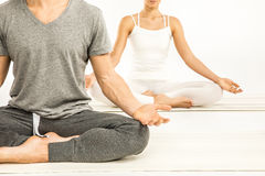 Couple sitting in lotus position Stock Photos