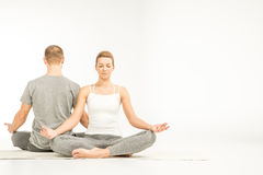Couple sitting in lotus position Stock Image