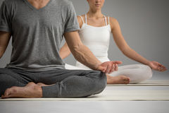 Couple sitting in lotus position Royalty Free Stock Images