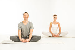 Couple sitting in lotus position Stock Images