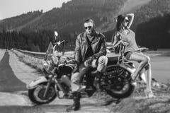 Couple sitting on a motorbike Royalty Free Stock Photos
