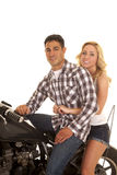 Couple sitting on a motorcycle western shirt smile close Stock Photo