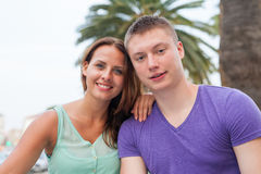 The couple sitting near the palm tree and spending great time. Royalty Free Stock Images