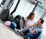Couple sitting near segways at sea front Stock Photos