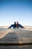 Couple sitting near water Royalty Free Stock Image