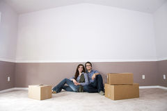 couple sitting in new home on moving day Royalty Free Stock Photo